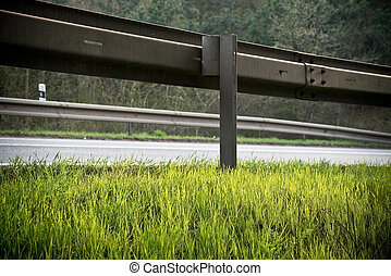 Guardrail - a crash barrier with roadside in the springtime
