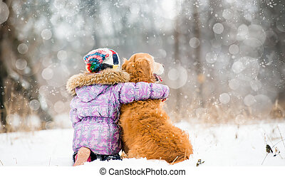 little girl with dog - little girl hugging dog and looks...