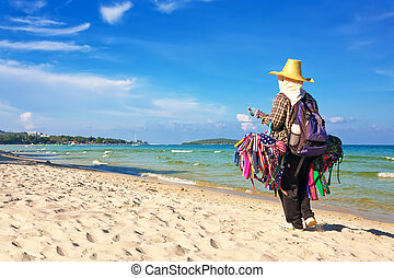 Thai woman selling beachwear