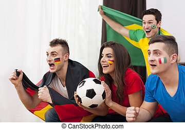 Portrait of young soccer fans during the match