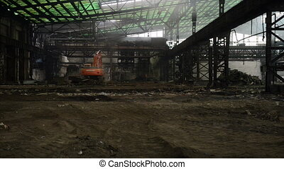 Construction machine inside industrial interior