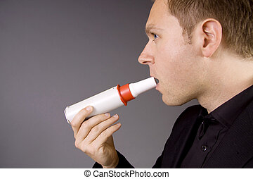 Lung capacity - An adult male is blowing in a peak flow...