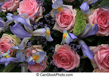 Blue irises and pink roses in bridal arrangement - Pink...
