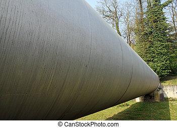 gigantic industrial pipeline for the transport of flammable liquid between two hidden tanks