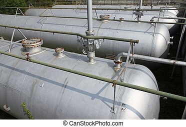 gray tanks and huge cistern the storage of gas and liquids -...