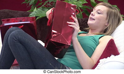 Woman on Sofa with Christmas Presents - Stock Video Footage...