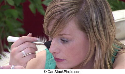 Woman Putting on make up - Stock Video Footage of a Woman...