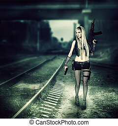 Sexy woman killer holding automatic and gun - Sexy blond...