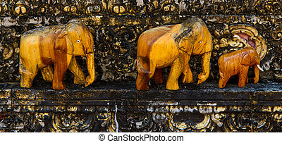 old Brown elephants engraving from wood walking together
