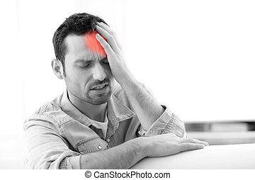 Young attractive man with a headache - View of Young...