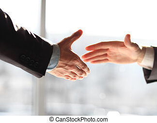 business men shaking hands - Two business men shaking hands,...