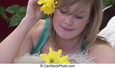 Woman Smelling a Flower - Stock Video Footage of a Woman...