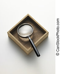 magnifying glass in the box - magnifying glass on white...
