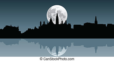 Ottawa Moonrise - A full moon rises behind the skyline of...
