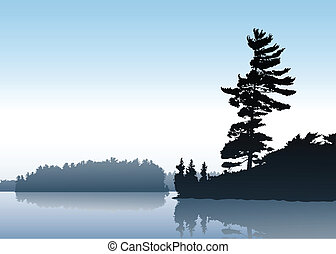 Morning Lake - Soft silhouette reflection of forest trees on...