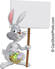 Easter bunny with eggs and sign - White Easter bunny holding...