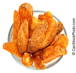 Spicy Potato Wedges in Glass Bowl Over White