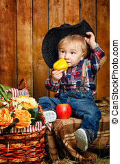 Little cowboy - Little Cowboy on a farm in a hat and jeans...