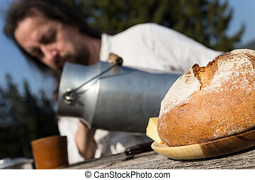 rural picnic with milk churn and bread - a rural picnic with...