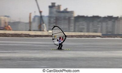 Windsurfing on the ice - Windsurfer on skis tracking focus