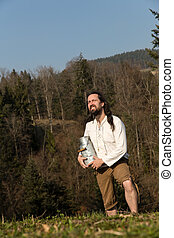 medieval farmer with milk can in the nature