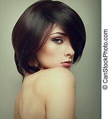 Vogue portrait of alluring woman with short hair style....