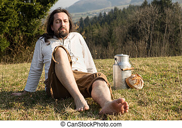 eremit in the nature with fresh milk and bread - a eremit in...