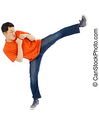 young man imitate a Karate to do standing side kick