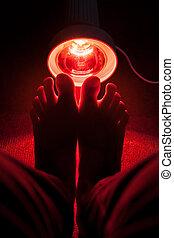 healing warmth - medicinal red-light-lamp radiating at a...
