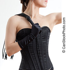 woman in a corset and whip - woman in black corset on a...