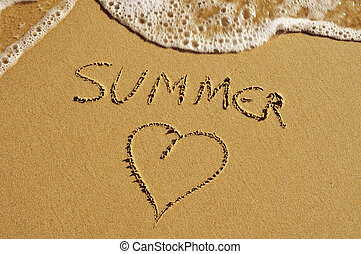 summer love - the word summer and a heart carved in the sand...