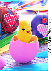 easter eggs - a teddy chick emerging from a hatched pink egg...