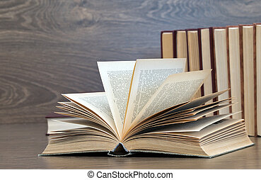books on a wooden background
