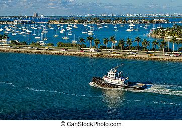 Boat Along Miami Shore - A boat cruises along the Miami,...