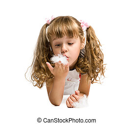 little girl blowing on a feather on a white background,...