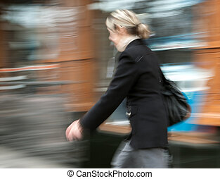 Woman walking in the street Intentional motion blur