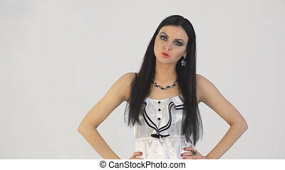 Girl swears. White background. - Wicked girl swears and...