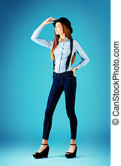 refined style - Elegant girl model poses in blouse, bow tie...