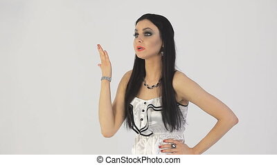 Girl swears White background - Wicked girl swears and waving...