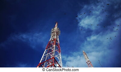 Birds Swarming Radio Cellular Tower - Eerie shot of many...