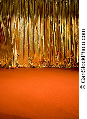 Golden curtain - a golden swag theatre curtain