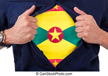 Young sport fan opening his shirt and showing the flag his country Grenada