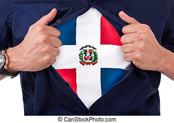 Young sport fan opening his shirt and showing the flag his country Dominican Republic