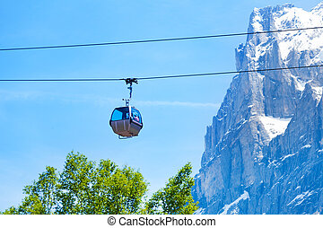 Funicular on ropeway near Alps - Funicular going on the...