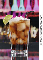 Cold cola in glass in a bar or party - Cold cola drink in...