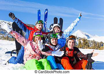 Positive friends with snowboards lifting hands up - Five...