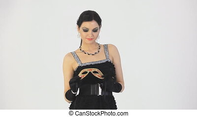 Beautiful woman in carnival mask. White background -...