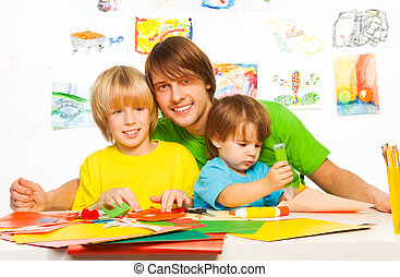 Little boys and father craft with glue - Happy dad with...