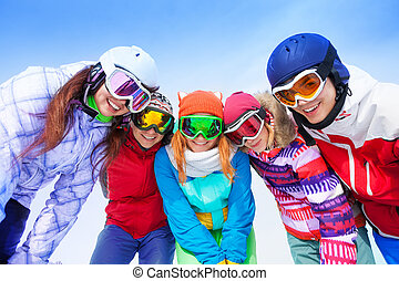 Happy friends posing with goggles - Happy smiling friends of...