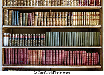 old books - bookcase with many old books in a library